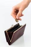 Plånbok och mynt arkivfoton