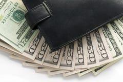 Plånbok och pengar arkivbild