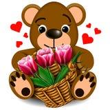 Plüsch-Teddybär mit Korb von Tulpen Stockbilder