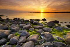 plaża na zachód słońca Zdjęcia Royalty Free
