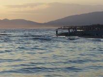 Plaża przy zmierzchem Zdjęcia Stock