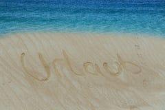Plaża z dopisanym w piaska słowie w Niemieckim wakacje zdjęcia royalty free