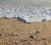 Plażowa morze piana, piasek i zdjęcia royalty free