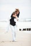 plażowi pary całowania potomstwa Obrazy Royalty Free
