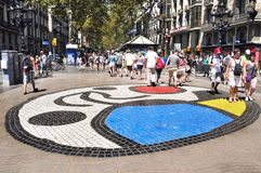 Pla de l'Os mosaic in Las Ramblas in Barcelona. BARCELONA, SPAIN - AUGUST Joan Miro's Pla de l'Os mosaic in La Rambla in Barcelona, Spain. Thousands of people stock photos