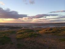 Plaża i zmierzchu niebo Obraz Stock