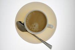 Plaat en kop van koffie met lepel Stock Afbeelding