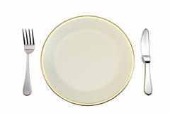 Plaat en mes en vork op een witte achtergrond Royalty-vrije Stock Foto's