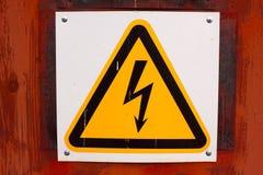Plaat gevaarlijk voltage Stock Afbeeldingen