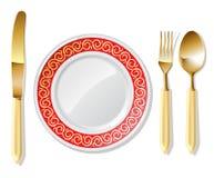 Plaat, gouden lepel, vork en mes Royalty-vrije Stock Foto's