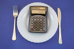 Plaat met calculator Stock Fotografie