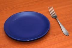 Plaat met een vork stock afbeelding