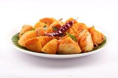Plaat van smakelijk ontbijt Chili Idly stock afbeelding