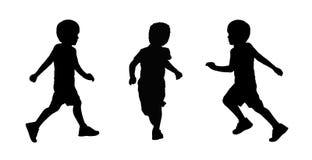 Plaatsen de weinig jongens lopende silhouetten 2 Stock Fotografie