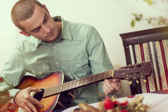 Plaaying the guitar Stock Images