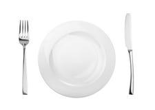 Placa, bifurcación vacía y cuchillo aislados en blanco, sin la sombra Imagen de archivo libre de regalías