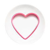 Placa blanca con el corazón Imagen de archivo