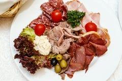 Placa clasificada de la carne en el abastecimiento del evento Imagen de archivo