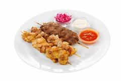 Placa clasificada del kebab aislada en blanco Imagen de archivo libre de regalías
