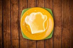 Placa colorida con símbolo blanco dibujado mano del cocinero Imagen de archivo libre de regalías