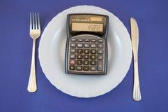 Placa com calculadora Fotografia de Stock