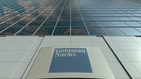 Placa com Goldman Sachs Group, Inc do Signage logo Lapso de tempo moderno da fachada do prédio de escritórios Rendição 3D editori video estoque