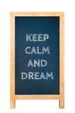 A placa com o texto mantém a calma e sonha Fotografia de Stock
