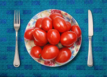 Placa com tomates Imagem de Stock Royalty Free