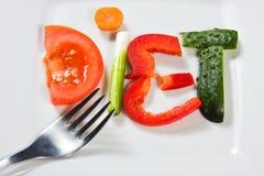 Placa com vegetais e dieta da palavra Imagem de Stock