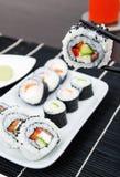 Placa con el conjunto del sushi Imágenes de archivo libres de regalías