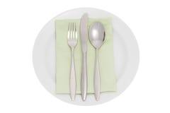 Placa con la cuchillería y la servilleta Imagen de archivo