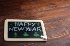 Placa con la Feliz Año Nuevo de la inscripción Imagenes de archivo