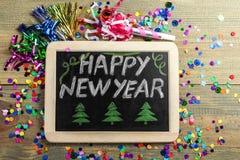 Placa con la Feliz Año Nuevo de la inscripción Fotos de archivo