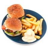 Placa con las hamburguesas Imagenes de archivo