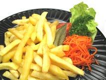 Placa con las patatas fritas Imagenes de archivo
