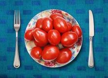Placa con los tomates Imagen de archivo libre de regalías
