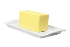 Placa con mantequilla Foto de archivo