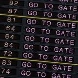 A placa da partida do aeroporto com vai bloquear o sinal foto de stock