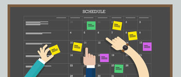 Placa da programação do calendário com plano da mão