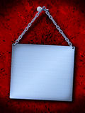 Placa de aço nova que pendura em um prego Imagens de Stock
