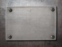 Placa de aço velha com parafusos no fundo do metal Imagem de Stock Royalty Free
