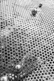 Placa de acero abstracta por la esfera del agujero y de la soldadura Fotos de archivo libres de regalías