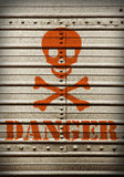Placa de acero con símbolo del peligro. Foto de archivo libre de regalías