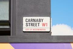 Placa de calle de Carnaby, calle famosa de las compras en Londres Fotografía de archivo