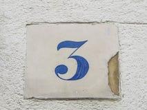 Placa de calle del número 3 Foto de archivo