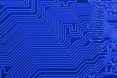 Placa de circuito eletrônico como um teste padrão abstrato do fundo Close-up macro tonificado Fotos de Stock