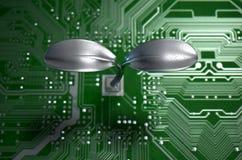 Placa de circuito macro com planta futurista Foto de Stock