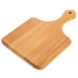 Placa de corte de madeira - tiro do estúdio Fotografia de Stock Royalty Free