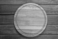 Placa de corte no fundo de madeira Fotografia de Stock