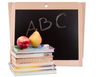 Placa de escola com os livros isolados Imagens de Stock